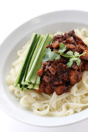 mian: zha jiang mian, chinese cuisine, noodles topped with fermneted soy bean paste and fresh cucumber