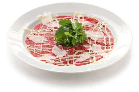 thinly: beef carpaccio with parmesan cheese and rucola Stock Photo