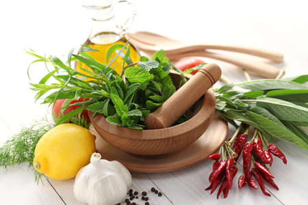 medical dressing: fresh herbs with mortar and pestle