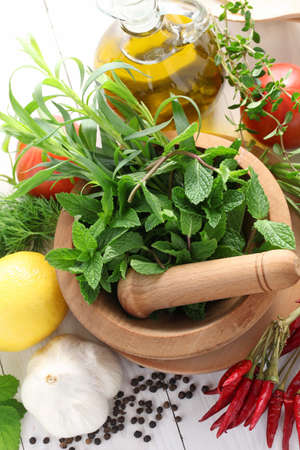 fresh herbs with mortar and pestle photo