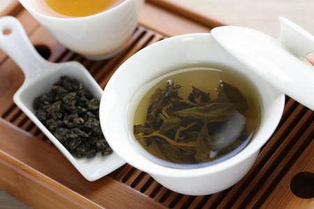 oolong: traditional chinese tea ceremony,oolong tea, gaiwan, tasting cup, bamboo tea tray
