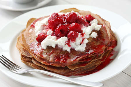 pancakes with ricotta and raspberry sauce,necci, italian chestnut flour crepes Stock Photo - 20237658