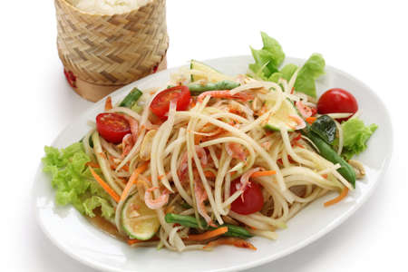 som tam thai, green papaya salad, sticky rice in bamboo container Stock Photo - 20471411