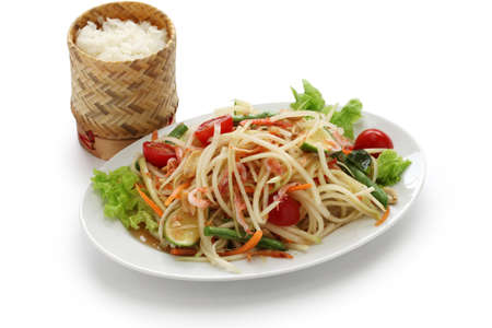 som tam thai, green papaya salad, sticky rice in bamboo container photo