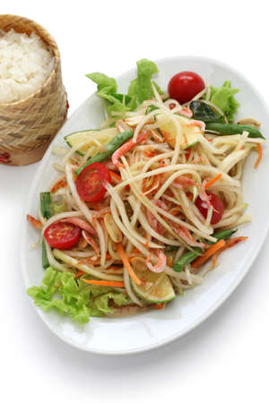 papaya: som tam thai, green papaya salad, sticky rice in bamboo container