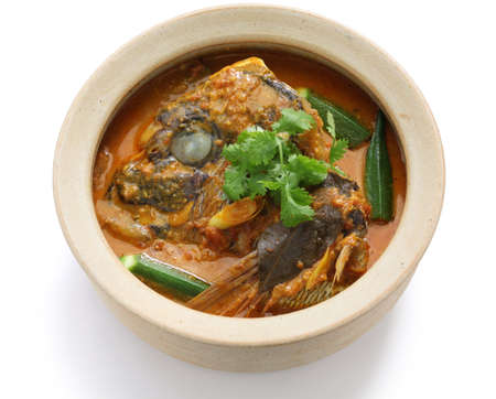 red head: fish head curry, singaporean cuisine, on white background