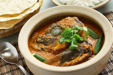 arroz: cabeza de pescado al curry, singapurense cocina Foto de archivo