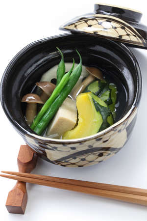 bean curd: Nimono is a simmered dish in Japanese cuisine  simmered squash, freeze-dried bean curd, green beans, rotus roots, and brown beech mushroom