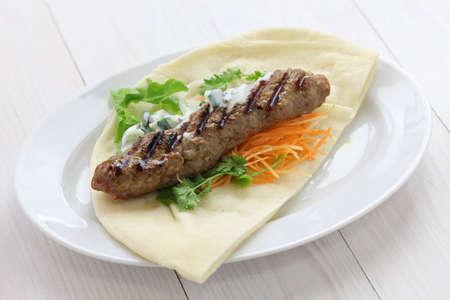 ground lamb kebab on flat bread photo