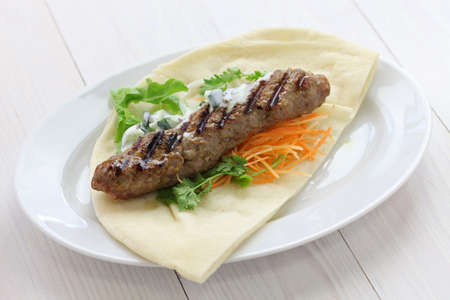 indian meal: ground lamb kebab on flat bread Stock Photo