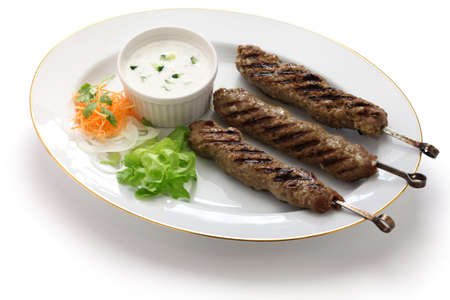 moroccan cuisine: ground lamb kebab on white background