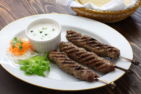ground lamb kebab with flat bread photo