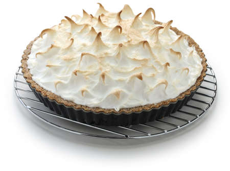 baked lemon meringue pie on cake cooler photo