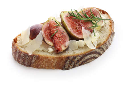 french cuisine: fig tartine, open sandwich isolated on white background