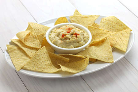 super bowl: tortilla chips with hummus dip for super bowl