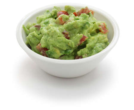 dipping: guacamole dip in bowl isolated on white background Stock Photo