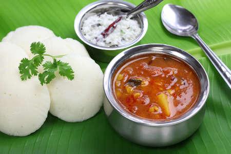 urad dal: idli, sambar and coconut chutney, south indian breakfast on banana leaf Stock Photo
