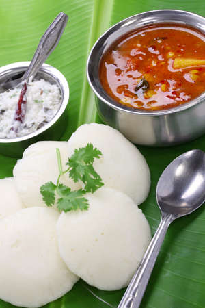 idli, sambar and coconut chutney, south indian breakfast on banana leaf photo