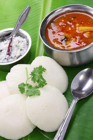 rice cake: idli, sambar and coconut chutney, south indian breakfast on banana leaf Stock Photo