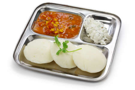 idli, sambar and coconut chutney, south indian breakfast on stainless steel plate photo