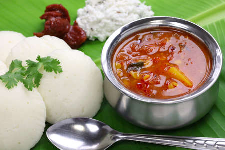 south india: idli, sambar, coconut and lime chutney, south indian breakfast on banana leaf