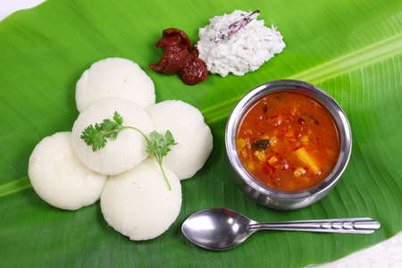 veg: idli, sambar, coconut and lime chutney, south indian breakfast on banana leaf