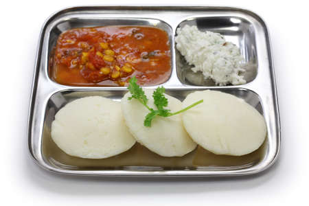 urad dal: idli, sambar and coconut, south indian breakfast on stainless steel plate