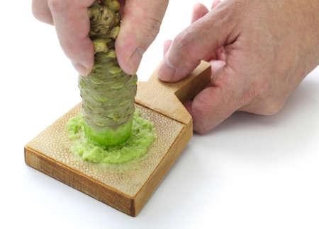 wasabi: grating fresh wasabi by shark skin grater, japanese condiment