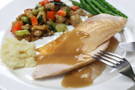 stuffing: slices of roast turkey with stuffing, thanksgiving day dinner