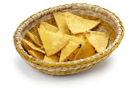 homemade tortilla chips in basket , totopos, mexican snack