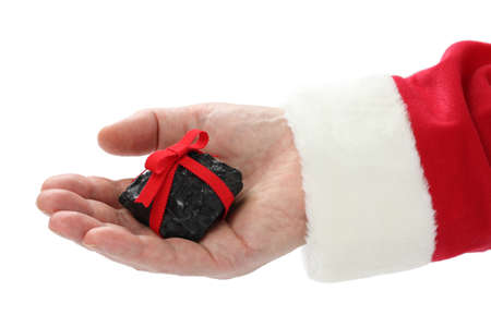 a coal with red ribbon on santa claus hand