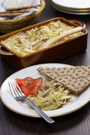 Janssons frestelse, Janssons temptation, Swedish potato gratin with sprat fillets photo