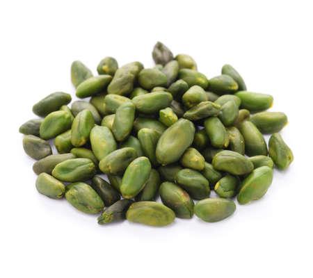 peeled: peeled pistachio on white background