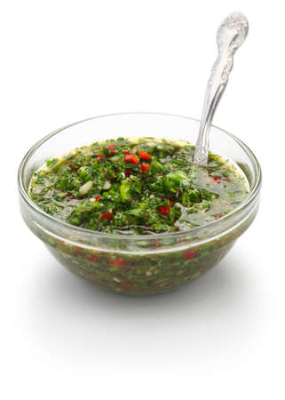 chimichurri sauce is a traditional Argentine condiment, made from finely chopped parsley, minced garlic, olive oil, oregano, and wine vinegar  photo