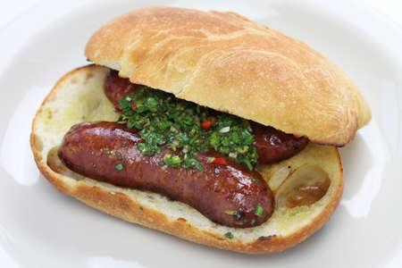 chorizo: choripan, chorizo hot dog with chimichurri sauce, Argentine food Stock Photo