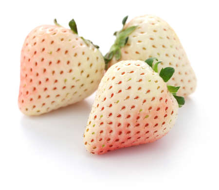 three white strawberries isolated on white background