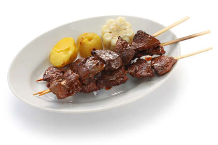 anticuchos, Peruvian cuisine, grilled skewered beef heart meat Stock Photo