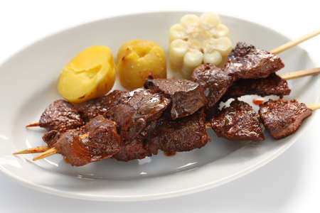 corazon: anticuchos, Peruvian cuisine, grilled skewered beef heart meat with boiled potato and white corn