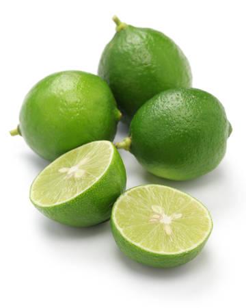 key: fresh key limes on white