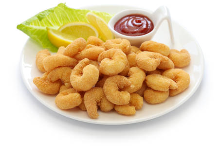 popcorn shrimp with ketchup sauce isolated on white background