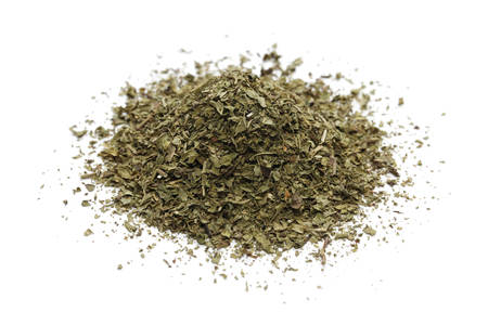 dried leaf: pile of dried mint  on white