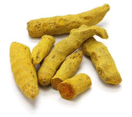 curcumin: dried whole turmeric on white