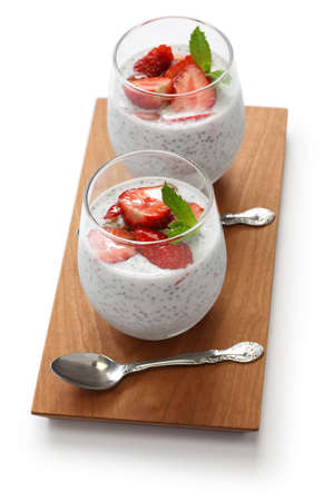 coconut chia seed pudding with strawberries isolated on white