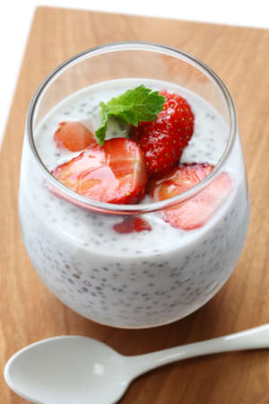pudding: coconut chia seed pudding with strawberries isolated on white