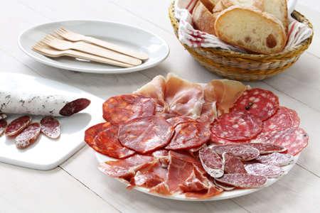 various types of  spanish salami, sausage and ham