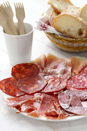 various types of  spanish salami, sausage and ham  photo