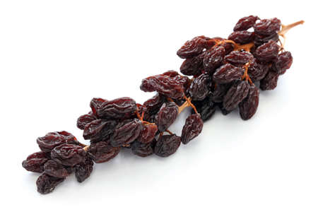 raisins: raisins on the vine isolated on white background