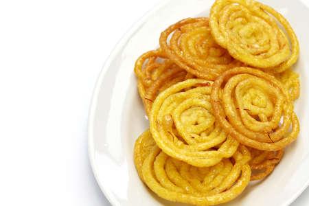 jalebi indian sweet isolated on white background photo