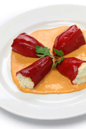 bacalao: pimientos del piquillo rellenos de bacalao, stuffed red peppers with cod cream sauce, spanish cuisine Stock Photo