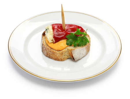 bacalao: spanish pinchos, pimientos del piquillo rellenos de bacalao, stuffed red peppers with cod cream sauce